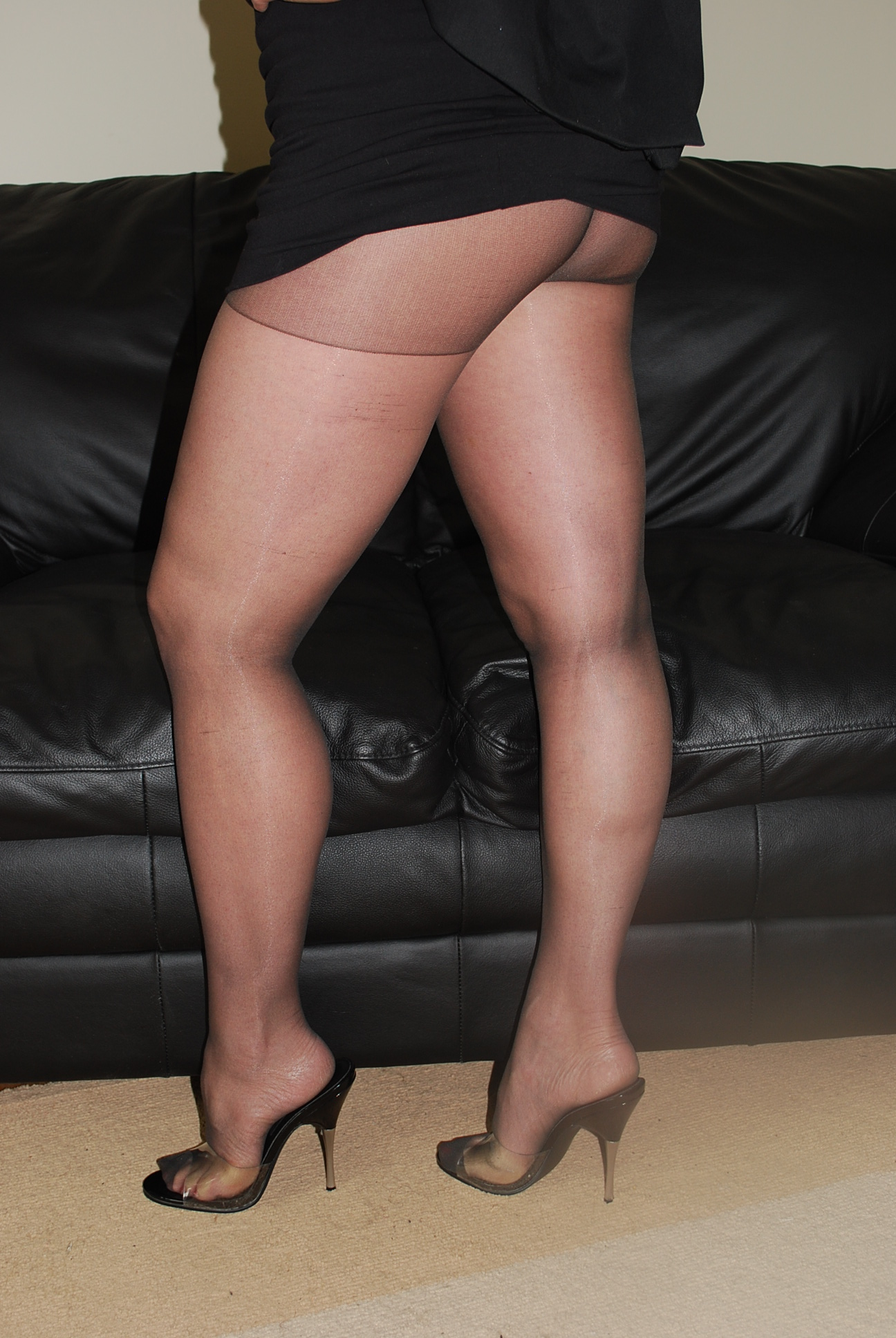 clad in sheer silky ff stockings and high heels   stockings girdles